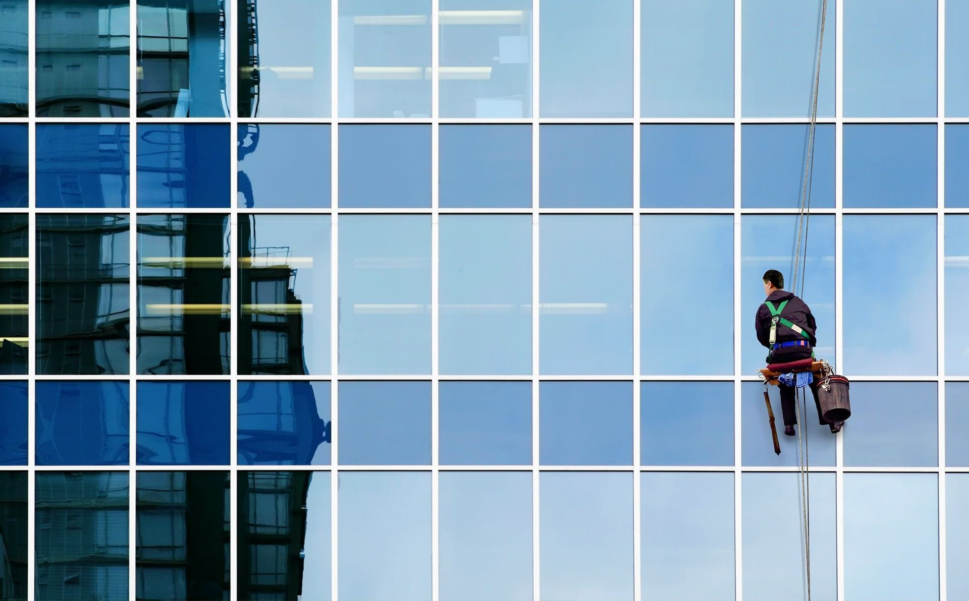 window washer on modern office building